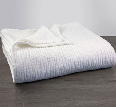 Coyuchi Organic Cotton Wave Matelasse Baby Blanket in Alpine White