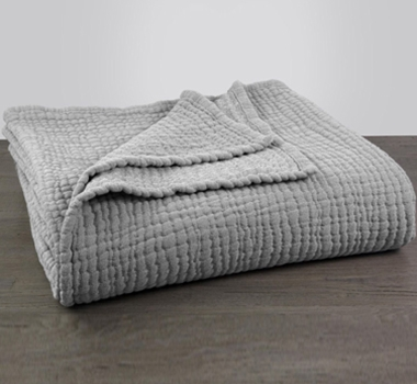 Coyuchi Organic Cotton Wave Matelasse Blanket in Gray Chambray