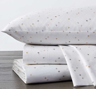 Coyuchi Scattered Sky Print Organic Cotton Fitted Crib Sheet in Warms