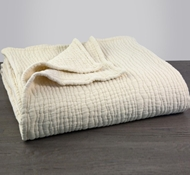 Coyuchi Organic Cotton Wave Matelasse Blanket in Natural